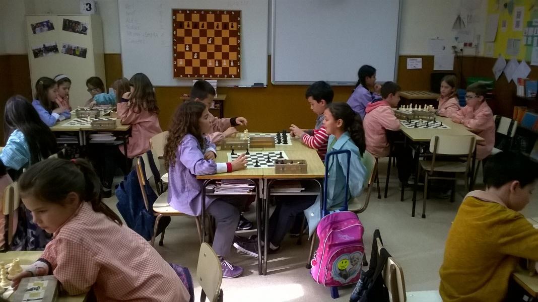 Fem escacs!